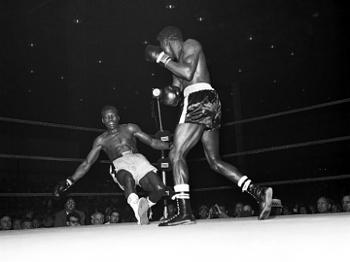 Griffith nocauteia Paret na 1ª luta entre eles