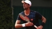 Thomaz Belucci, na estreia em Roland Garros contra Dusan Lajovic