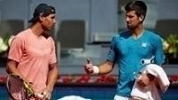 Rafael Nadal e Novak Djokovic após treino para o Masters de Madri