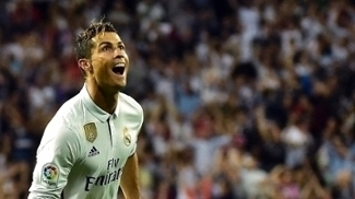 Cristiano Ronaldo comemora contra o Sevilla: 401 gols pelo Real Madrid
