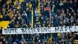 'Boa recuperação, Marc (Bartra)', desejam os torcedores do Dortmund em faixa