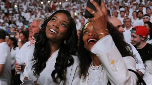 Jogo 7, Finais da NBA em 2013: ali, apoiando seu marido, Dwyane Wade, está a sorridente Gabrielle Union (à esq.). Ah, esse foi o jogo do título do Hea