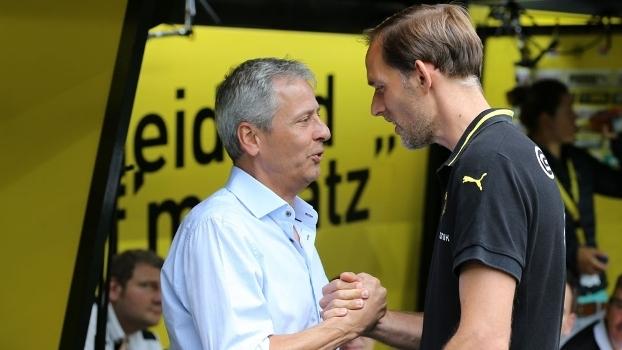Favre (à esq.) vem sendo apontado como possível substituto de Tuchel no Dortmund