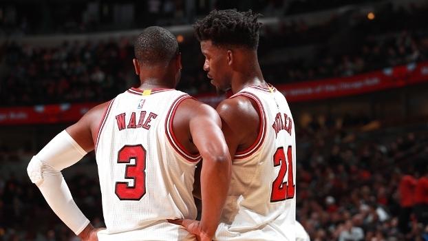 Jimmy Butler (21) busca o mesmo sucesso de Wade (3) na NBA