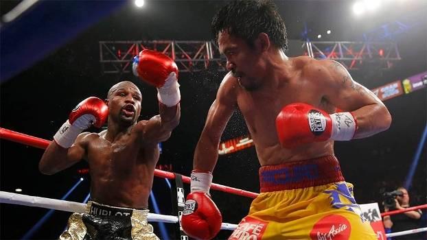 Floyd Mayweather Jr. golpeia Manny Pacquiao na 'luta do século' em Las Vegas, EUA