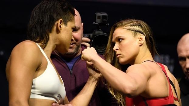 Amanda Nunes e Ronda Rousey em encarada