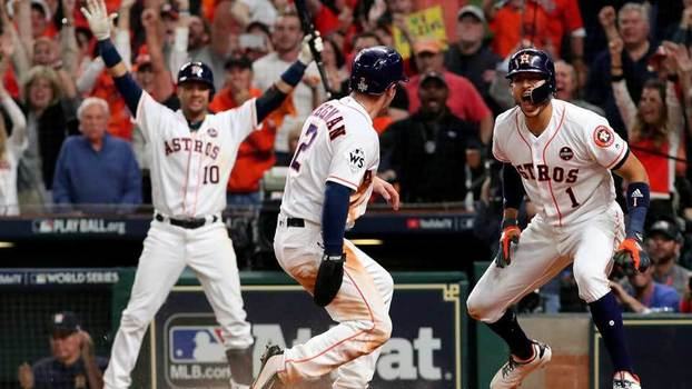 Houston Astros celebram corrida durante a World Series de 2017