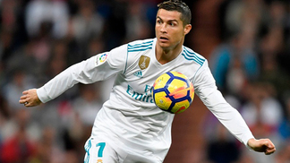 Real Madrid's Portuguese forward Cristiano Ronaldo controls the ball during the Spanish league football match Real Madrid CF against Malaga CF on 25,