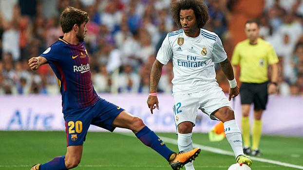 Assistência para Benzema, inversão de pé direito e troféu em mãos: veja como Marcelo atropelou a marcação do Barça