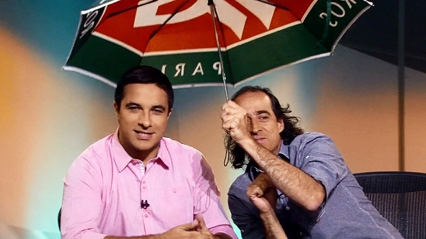Nardini e Meligeni abrem 'Pelas Quadras' com guarda-chuva após cancelamento de jogos