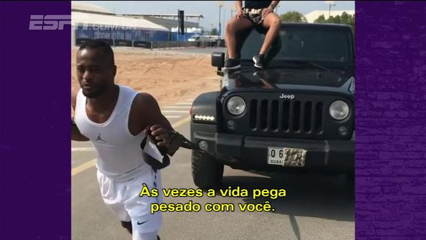 Suspenso por agredir torcedor, Evra aparece puxando carro e diz: 'Vou voltar mais forte do que nunca!'