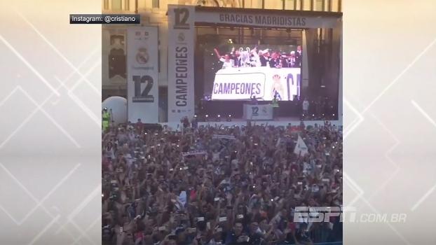 Jogadores do Real são recebidos por multidão pelas ruas de Madri, e Cristiano Ronaldo grava a festa